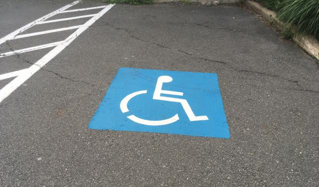 Handicap Space with blue painted marker on the ground
