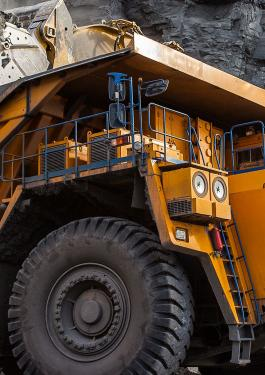 Dump truck collecting coal at a mining site