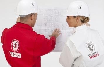 Two Bureau Veritas Employees reviewing project plans