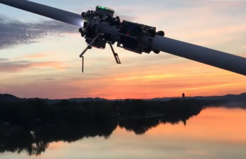 Robotic testing device moving on a beam during sunset